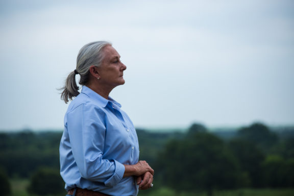 Deborah Clark overlooks her ranchland, which she and her husband have transformed using holistic land management practices.